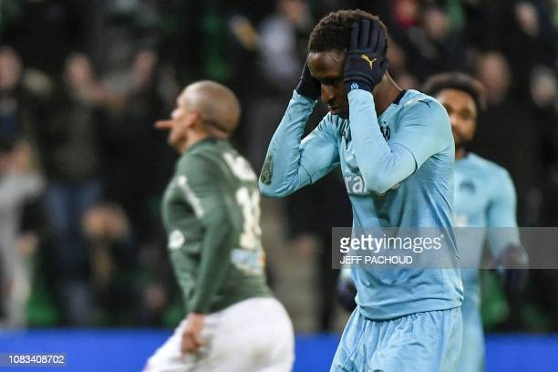Olympique de Marseille's French forward Bouna Sarr reacts after SaintEtienne's Tunisian midfielder Wahbi Khazri scored a goal during the French L1...