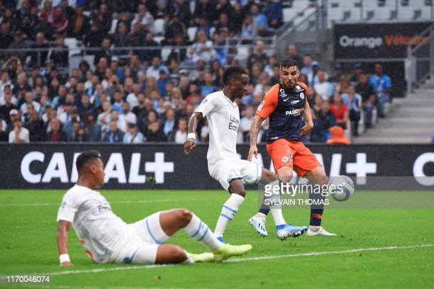 Olympique de Marseille's French forward Bouna Sarr scores an own goal during the French L1 football match between Olympique de Marseille and...