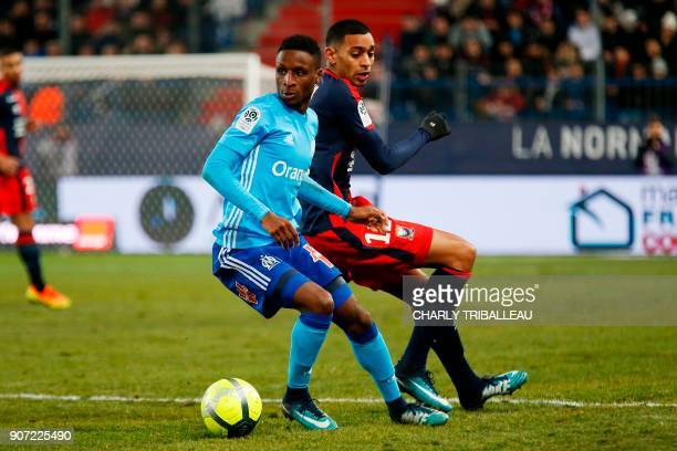 Olympique de Marseille's French forward Bouna Sarr vies for the ball with Caen's French forward Sylvio Ronny Rodelin during the French L1 football...