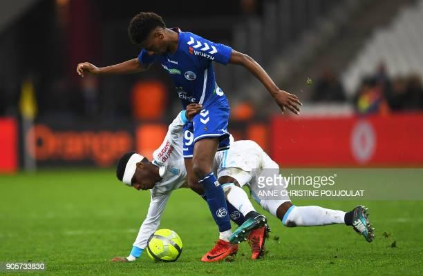 Olympique de Marseille's French forward Bouna Sarr vies with Strasbourg's Cape Verdian forward Nuno Da Costa on January 16 2018 at the Velodrome...