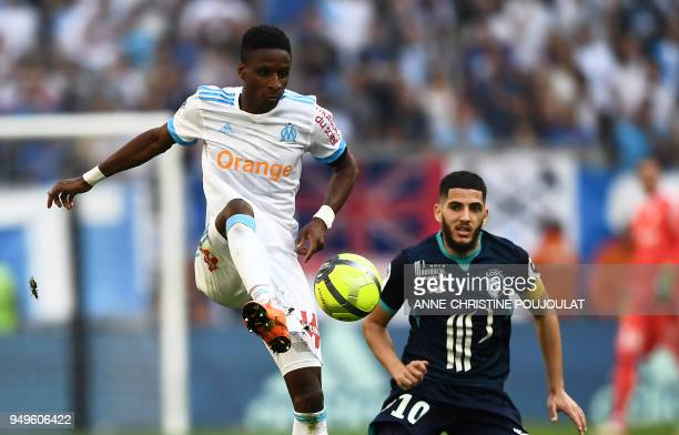 Olympique de Marseille's French forward Bouna Sarr vies with Lille's French forward Yassine Benzia on April 21 2018 at the Velodrome stadium in...