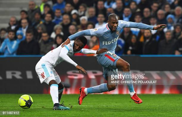Olympique de Marseille's French forward Bouna Sarr vies with Monaco's French defender Djibril Sidibe during the French L1 football match Marseille vs...