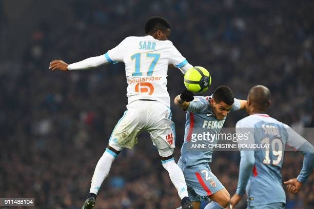 Olympique de Marseille's French forward Bouna Sarr vies with Monaco's Brazilian midfielder Rony Lopes during the French L1 football match Marseille...