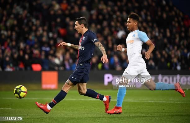 Olympique de Marseille's French forward Bouna Sarr vies with Paris SaintGermain's Argentinian forward Angel Di Maria during the French L1 football...