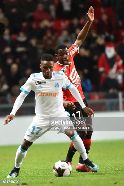 Olympique de Marseille's French forward Bouna Sarr vies with Rennes' French midfielder ChristEmmanuel Faitout Maouassa during the French League Cup...