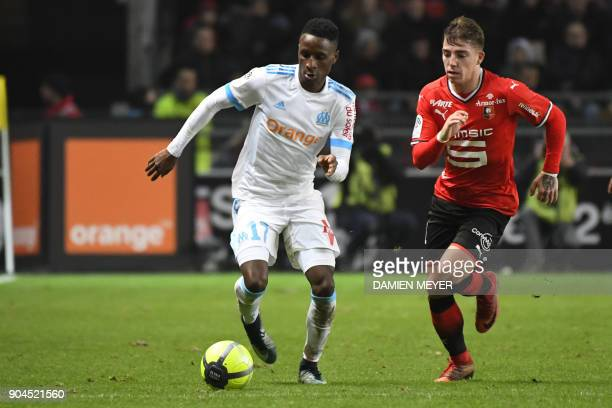 Olympique de Marseille's French forward Bouna Sarr vies with Rennes' French forward Thomas Brandon during the French L1 football match Rennes vs...