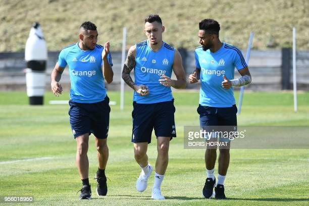 Olympique de Marseille's French forward Dimitri Payet Argentinian forward Lucas Ocampos and French defender Jordan Amavi warm up during the Europa...