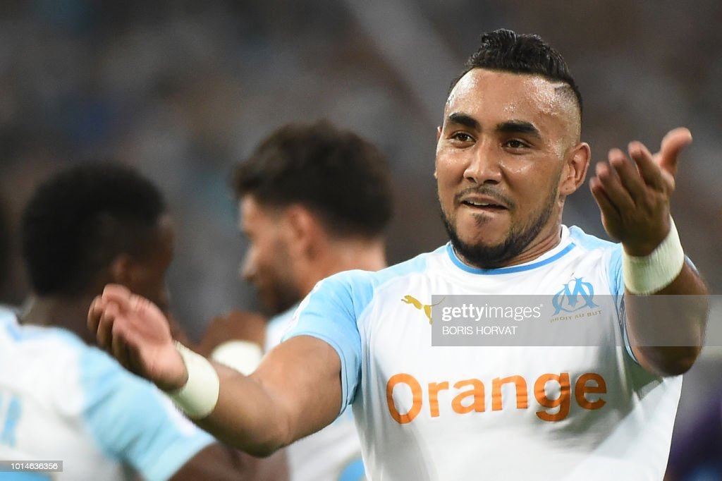 Olympique de Marseille's French forward Dimitri Payet celebrates after scoring the second goal during the French L1 football match between Olympique de Marseille (OM) and Toulouse at the Velodrome stadium, in Marseille, on August 10, 2018.