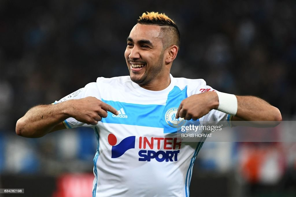 Olympique de Marseille's French forward Dimitri Payet celebrates after scoring the second goal during the French Ligue 1 football match between Olympique de Marseille (OM) and Guingamp at the Velodrome stadium in Marseille on February 8, 2017. /