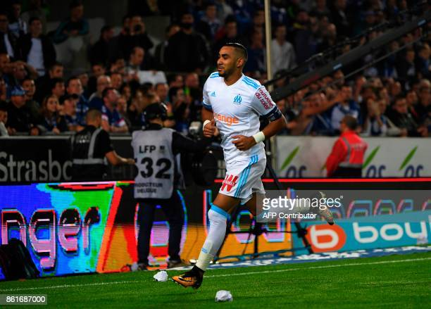 Olympique de Marseille's French forward Dimitri Payet celebrates after scoring a goal during the French Ligue 1 football match between Strasbourg and...