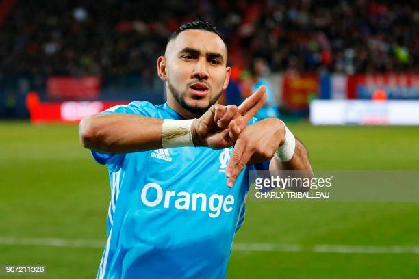 Olympique de Marseille's French forward Dimitri Payet celebrates after scoring during the French L1 football match between Caen and Marseille on...