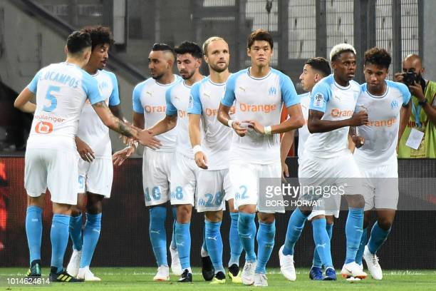 Olympique de Marseille's French forward Dimitri Payet celebrates with teammates after scoring a penalty kick during the French L1 football match...