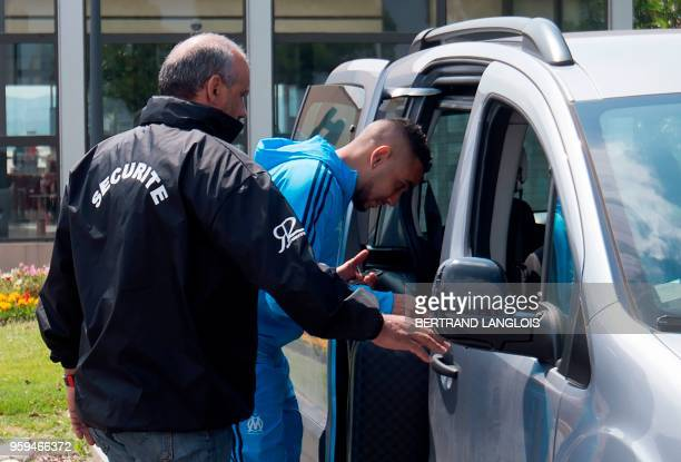 Olympique de Marseille's French forward Dimitri Payet climbs into a vehicle as he leaves the MarseilleProvence airport in Marignane southern France...
