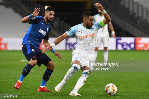 Olympique de Marseille's French forward Dimitri Payet competes for the ball with Apollon Limassol's Mauritius midfielder Kevin Bru during the UEFA...