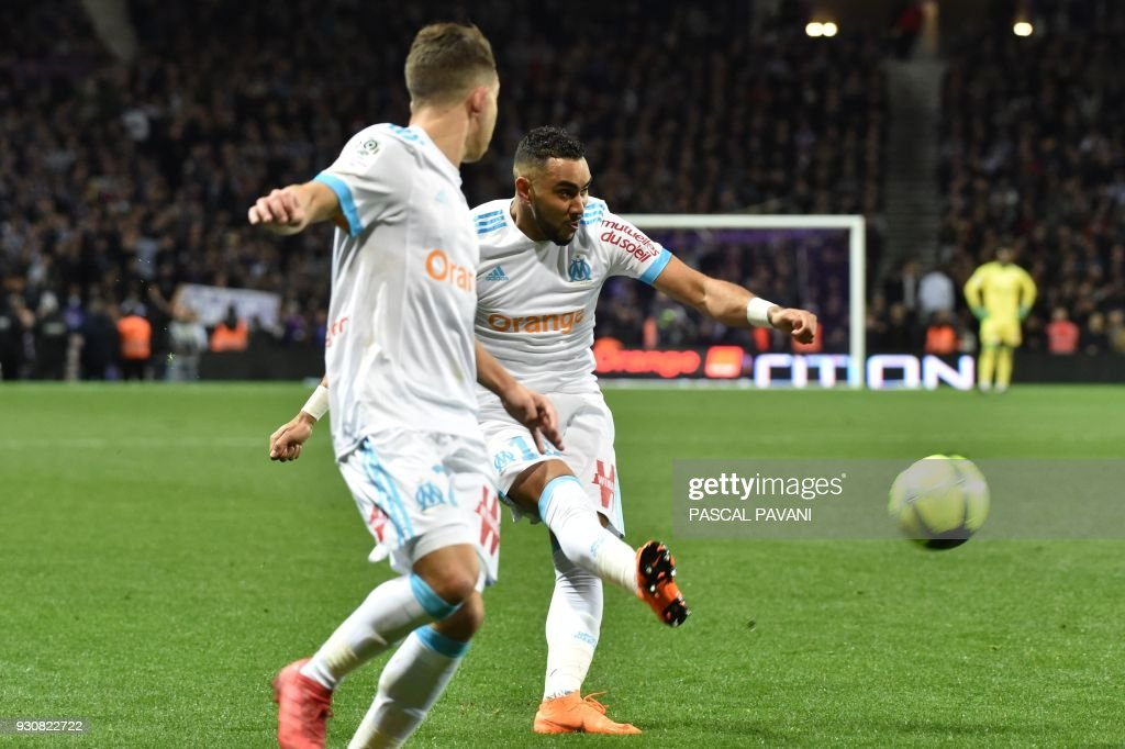 Olympique de Marseille's French forward Dimitri Payet (R) controls the ball during the French L1 football match between Toulouse (TFC) and Marseille (OM) at the Municipal Stadium in Toulouse, southern France on March 11, 2018. /