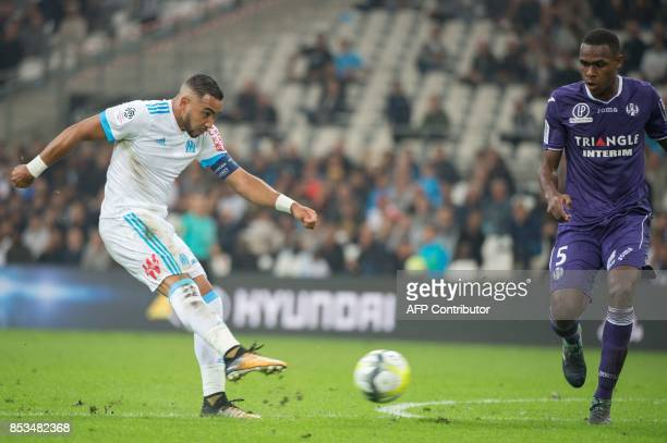 Olympique de Marseille's French forward Dimitri Payet kicks the ball despite Toulouse's French defender Issa Diop during the French L1 football match...