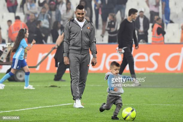 Olympique de Marseille's French forward Dimitri Payet plays football with a child at the end of the French L1 football match Olympique of Marseille...