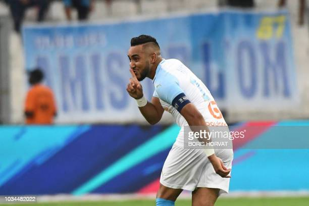 Olympique de Marseille's French forward Dimitri Payet reacts after scoring during their French L1 football match Olympique of Marseille versus EA...