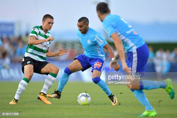 Olympique de Marseille's French forward Dimitri Payet vies for the ball with Sporting's Potugese midfielder Joao Palhinha during a friendly football...