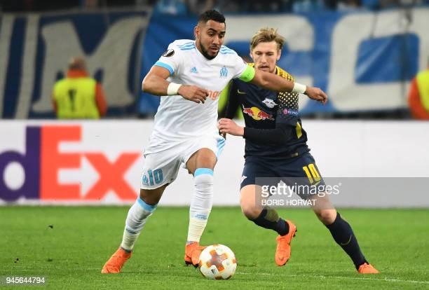 Olympique de Marseille's French forward Dimitri Payet vies for the ball with Leipzig's Swedish midfielder Emil Forsberg during the Europa League...