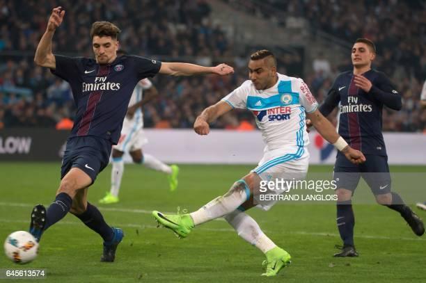 Olympique de Marseille's French forward Dimitri Payet vies with Paris SaintGermain's Belgian defender Thomas Meunier during the French L1 football...