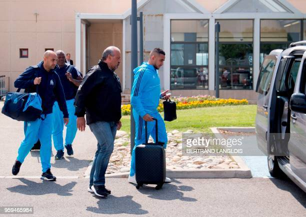 Olympique de Marseille's French forward Dimitri Payet walks towards a vehicle as he leaves the MarseilleProvence airport in Marignane southern France...