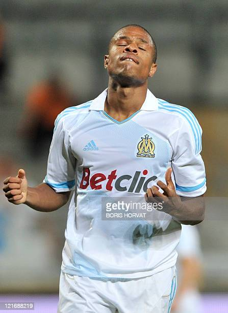 Olympique de Marseille's French forward Loic Remy reacts after missing a goal during the French L1 football match Olympique de Marseille vs...