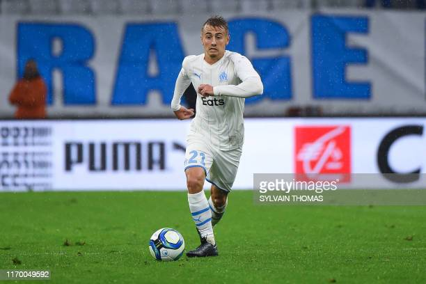 Olympique de Marseille's French forward Valentin Rongier runs with the ball during the French L1 football match between Olympique de Marseille and...