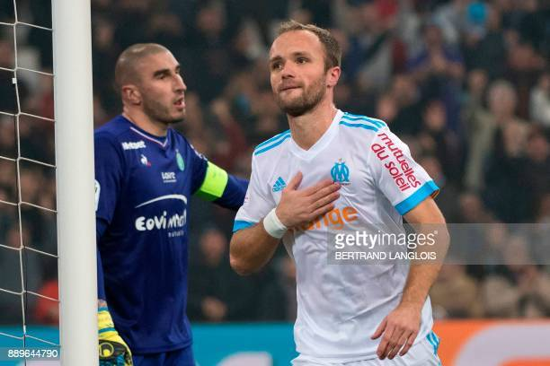 Olympique de Marseille's French forward Valere Germain celebrates after scoring against SaintEtienne's goalkeeper Stephane Ruffier during the French...