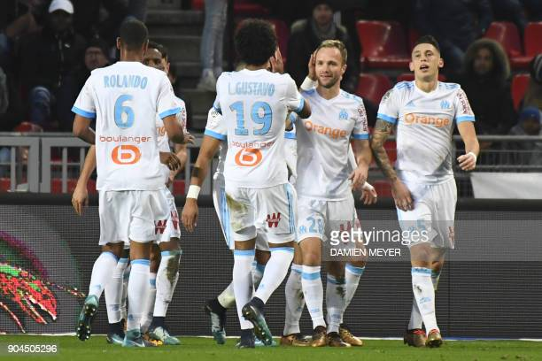 Olympique de Marseille's French forward Valere Germain celebrates with teammates after scoring a goal during the French L1 football match Rennes vs...
