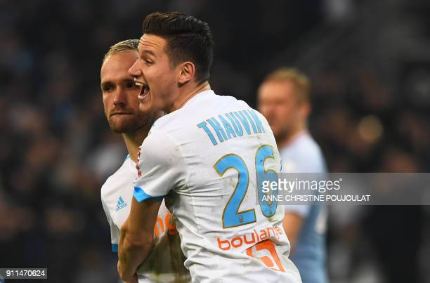 Olympique de Marseille's French forward Valere Germain celebrates with Olympique de Marseille's French midfielder Florian Thauvin after scoring a...