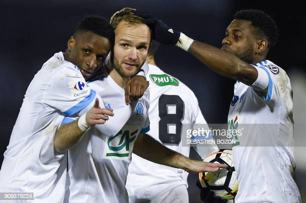 Olympique de Marseille's French forward Valere Germain is congratulated by teammates after scoring a goal during the French Cup football match...