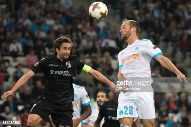 Olympique de Marseille's French forward Valere Germain vies with Guimaraes' midfielder Rafael Miranda during the UEFA Europa League Group I football...