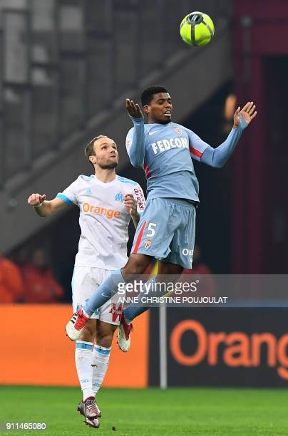 Olympique de Marseille's French forward Valere Germain vies with Monaco's Brazilian defender Jemerson during the French L1 football match Marseille...