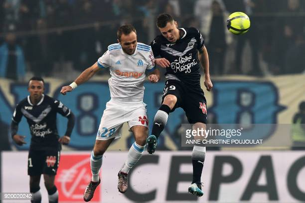 Olympique de Marseille's French forward Valere Germain vies with Bordeaux's Danish midfielder Lukas Lerager during the French L1 football match...