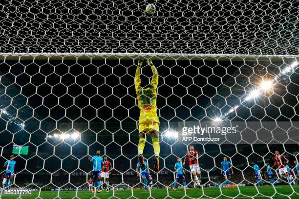 Olympique de Marseille's French goalkeeper Steve Mandanda jumps to stop the ball during the French L1 football match between Nice and Marseille on...
