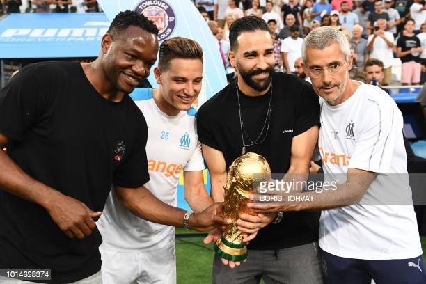 Olympique de Marseille's French goalkeeper Steve Mandanda Olympique de Marseille's French midfielder Florian Thauvin Olympique de Marseille's French...