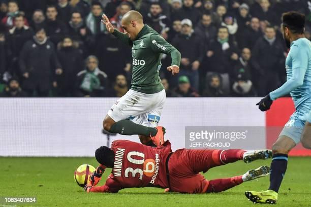 Olympique de Marseille's French goalkeeper Steve Mandanda tackles SaintEtienne's Tunisian midfielder Wahbi Khazri during the French L1 football match...
