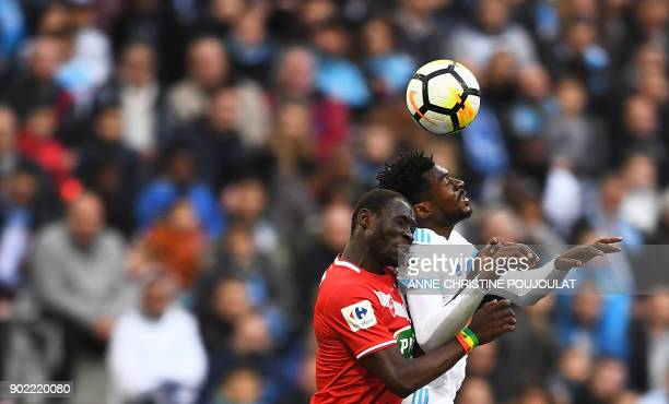 Olympique de Marseille's French midfielder Andre Zambo Anguissa vies with Valenciennes' defender Caliou Ciss during the French Cup football match...