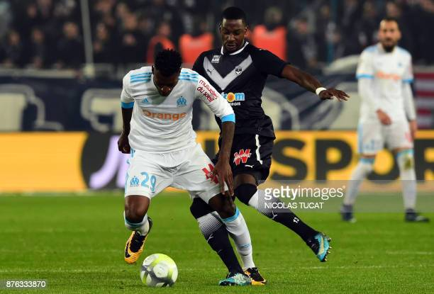 Olympique de Marseille's French midfielder AndreFrank Zambo Anguissa vies with Bordeaux's Senegalese midfielder Younousse Sankhare during the French...