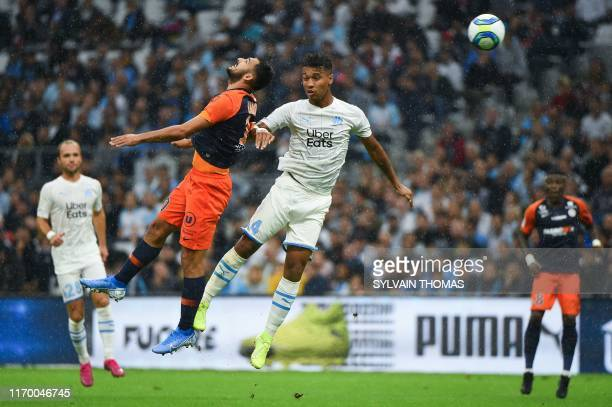 Olympique de Marseille's French midfielder Boubacar Kamara fights for the ball with Montpellier's French forward Gaetan Laborde during the French L1...