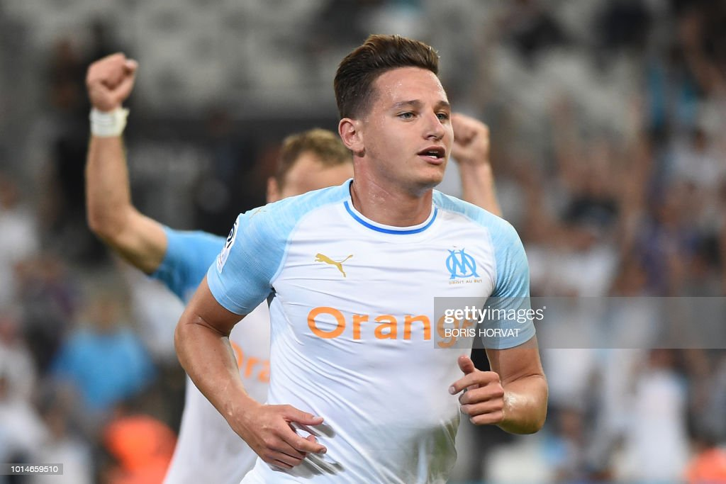 Olympique de Marseille's French midfielder Florian Thauvin celebrates after scoring a goal during the French L1 football match between Olympique de Marseille (OM) and Toulouse at the Velodrome stadium, in Marseille, on August 10, 2018.