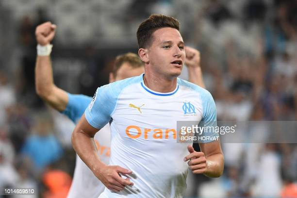 Olympique de Marseille's French midfielder Florian Thauvin celebrates after scoring a goal during the French L1 football match between Olympique de...
