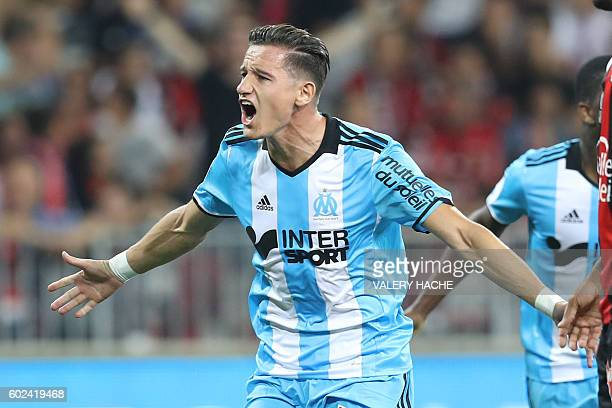 Olympique de Marseille's French midfielder Florian Thauvin celebrates after scoring a goal during the French L1 football match OGC Nice vs Olympique...