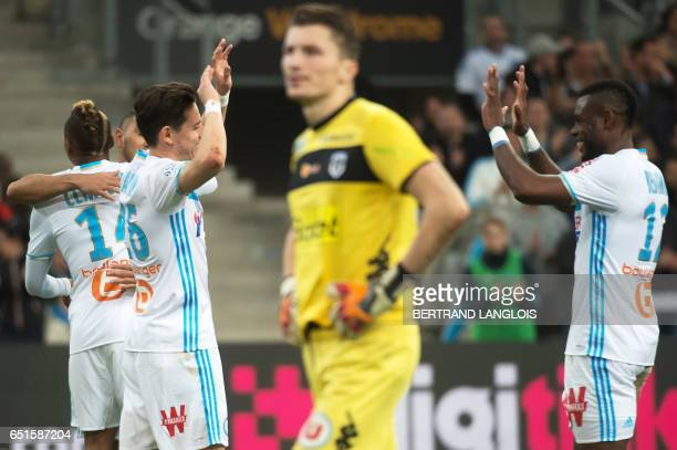 Olympique de Marseille's French midfielder Florian Thauvin celebrates with Olympique de Marseille's Cameroonian defender Henri Bedimo after scoring...