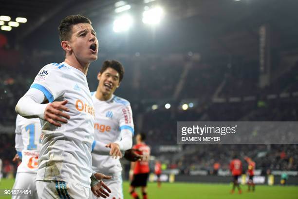 Olympique de Marseille's French midfielder Florian Thauvin celebrates after scoring a goal during the French L1 football match Rennes vs Marseille on...