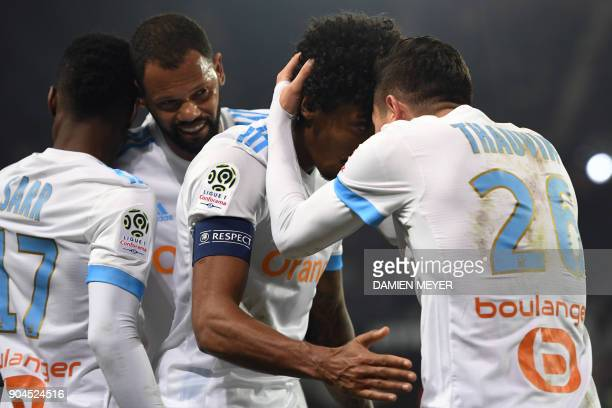 Olympique de Marseille's French midfielder Florian Thauvin celebrates with teammates after scoring a goal during the French L1 football match Rennes...