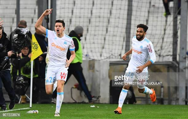 Olympique de Marseille's French midfielder Florian Thauvin celebrates after scoring a goal with Marseille's French defender Jordan Amavi on March 04...