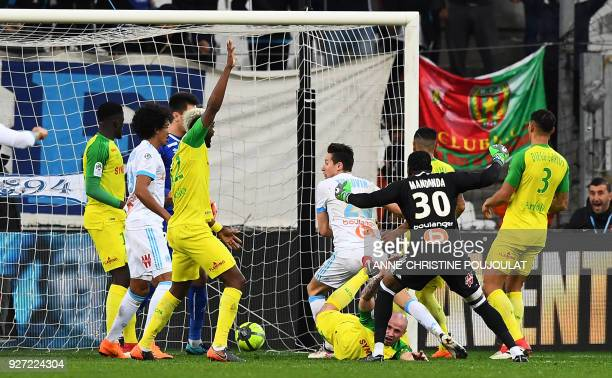 Olympique de Marseille's French midfielder Florian Thauvin celebrates after scoring a goal on March 04 2018 at the Velodrome stadium in Marseille...