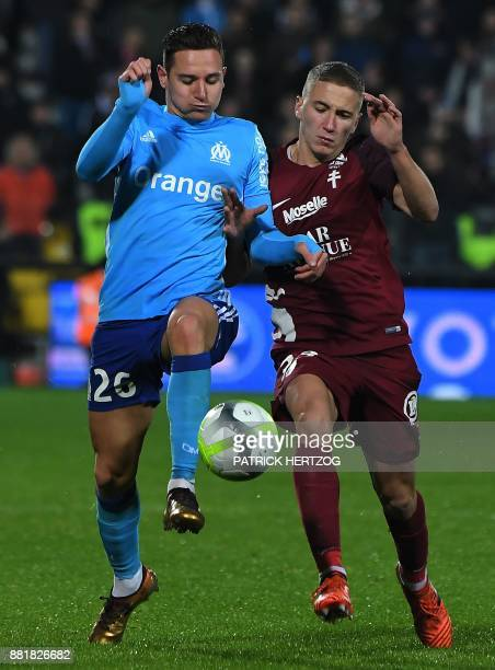 Olympique de Marseille's French midfielder Florian Thauvin fights for the ball with Metz' French defender Nicolas Basin during the French Ligue 1...